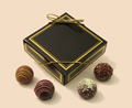 Caramels | 4-piece box - Rich caramel, with a trace of vanilla, covered with pure milk or dark chocolate.  Four-piece box personalized with your choice of message.