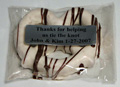 "Bavarian Pretzel | Printed Message - A large Bavarian pretzel, dipped in kettles of pure chocolate, and then wrapped in a clear cello bag and labeled with a personalized message.  The pretzel is available in milk, dark or white chocolate, with contrasting chocolate drizzle.  A favorite message is ""Thank you for helping us tie the knot.  Love Jack & Jill.""  Price includes printing with a minimum of 25 pieces."