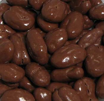 Chocolate Amaretto Pecan Halves - Large pecan halves are covered in a luscious amaretto flavored milk chocolate.  A great taste packaged in our one-pound signature box with a gold cord.