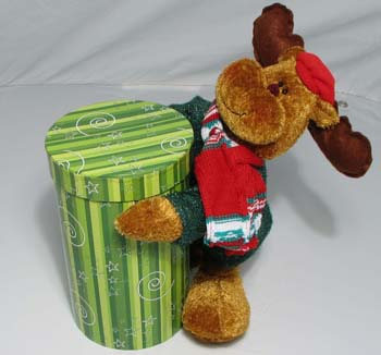 Green Box & Reindeer | Chocolate Covered Peanuts - This special plush reindeer is holding a large round box of double dipped chocolate covered peanuts.  A decorative bow is attached at the top.