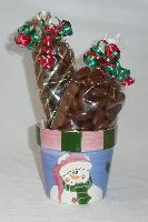 Round Snowman - A cute snowman pot filled with ½ pound of chocolate covered caramel corn and ¾ pound of chocolate covered almonds decorated with festive colored ribbons.